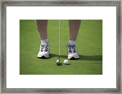 Golfing Lining Up The Putt Framed Print by Thomas Woolworth