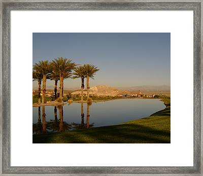 Golfing Oasis Framed Print by Larry Underwood