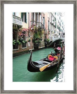 Gondola By The Restaurant Framed Print by Donna Corless