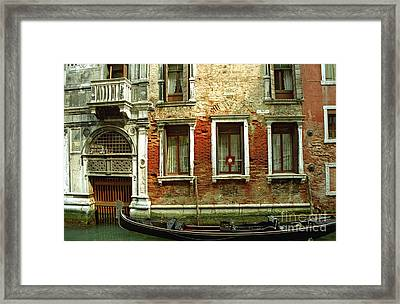 Gondola In Front Of House In Venice Framed Print by Michael Henderson