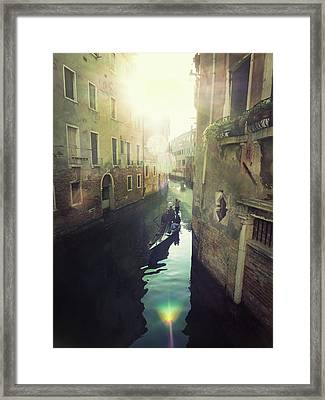 Gondolas In Venice Against Sun Framed Print by Marco Misuri