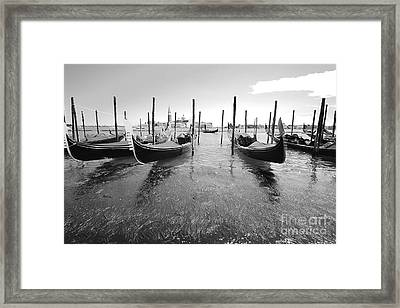 Gondolier In The Distance Framed Print by Floyd Menezes