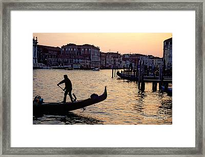 Gondolier In Venice In Silhouette Framed Print by Michael Henderson