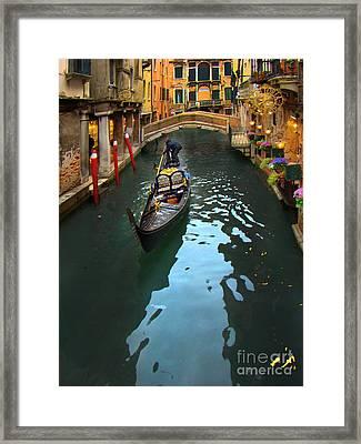 Gondolier In Venice, Italy Framed Print