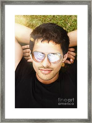 Good Looking Man Lying Down On Playing Field Framed Print