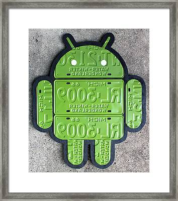 Google Android Logo Recycled License Plate Art On Cement Wall Framed Print by Design Turnpike