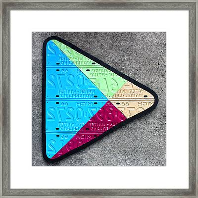 Google Play Logo Recycled License Plate Art On Cement Wall Framed Print by Design Turnpike