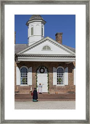 Gossip At The Courthouse Framed Print