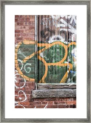 Framed Print featuring the photograph Graffiti Covered Wall Of An Old Abandoned Factory by Edward Fielding