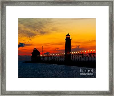 Grand Haven Sunset Framed Print by Nick Zelinsky