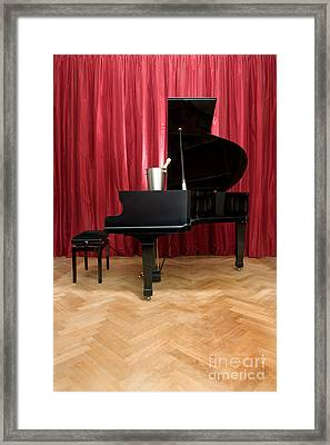 Grand Piano With A Champagne Cooler Framed Print by Corepics