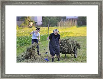 Granddaughter And Grandmother Sharing The Load Framed Print by Don Wolf