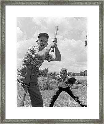 Grandfather At Bat With Boy As Catcher Framed Print by Debrocke/ClassicStock