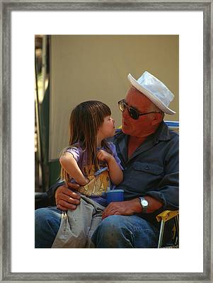 Grandfather Holding His Little Granddaughter On A Camping Trip Framed Print