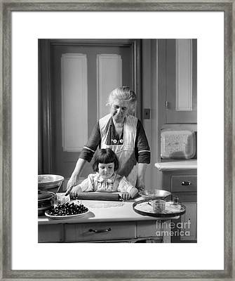 Grandmother And Granddaughter Baking Framed Print by H. Armstrong Roberts/ClassicStock