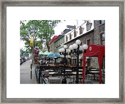 Framed Print featuring the photograph Grande Allee Est by John Schneider