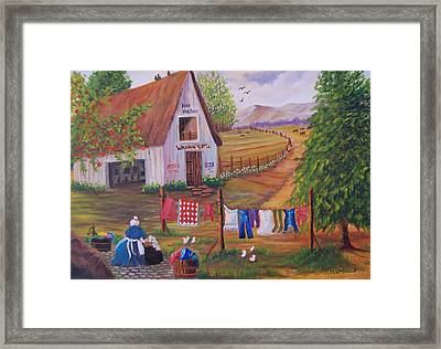 Granny And Her Laundry Framed Print by Janna Columbus