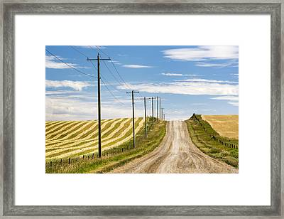 Gravel Road Climbing A Hill With Wooden Framed Print