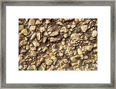 Framed Print featuring the photograph Gravel Stones On A Wall by John Williams
