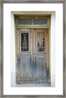 Greek Door With Wrought Iron Window Framed Print by Maria Varnalis