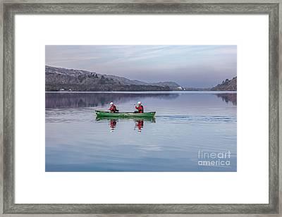 Green Canoe Framed Print by Adrian Evans