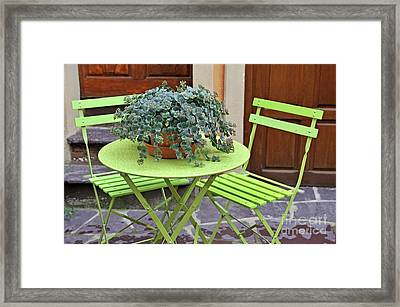 Green Chairs And Table With Plant In Pot Framed Print by Sami Sarkis