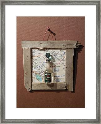 Green Marble Suspended Over Vodka In A Glass Bottle Framed Print by Jim Ramirez