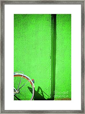 Framed Print featuring the photograph Green Wall And Bicycle Wheel by Silvia Ganora