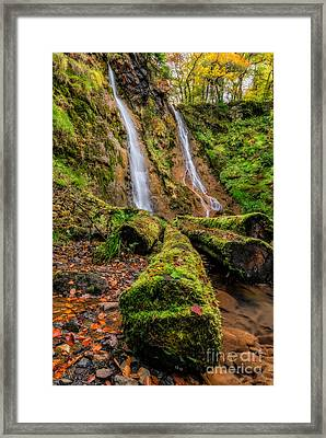 Grey Mares Tail Waterfall Framed Print by Adrian Evans