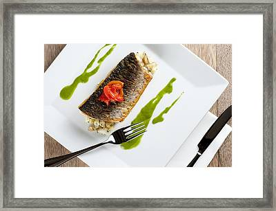 Grey Mullet With Watercress Sauce Presented On A Square White Plate With Cutlery And Napkin Framed Print by Andy Smy