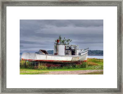 Grounded Fishing Boat Framed Print by Rick Mann