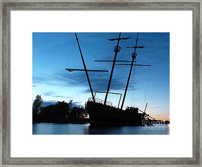 Grounded Tall Ship Silhouette Framed Print