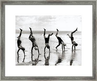 Group Of People Doing Handstands On Beach (b&w) Framed Print by Hulton Archive