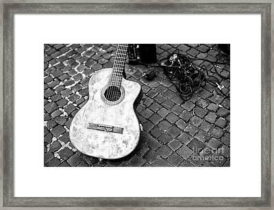 Guitar In Rome Framed Print by John Rizzuto
