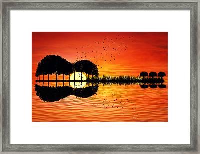 Guitar Island Sunset Framed Print