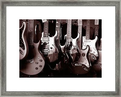 Guitar Shop Framed Print by David April