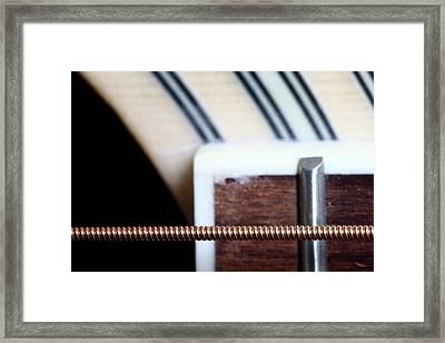 Guitar String Framed Print