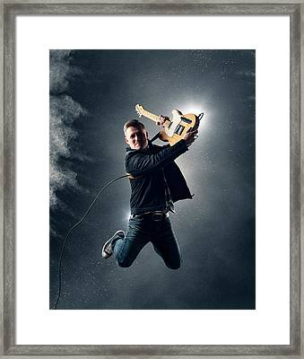 Guitarist Jumping High Framed Print by Johan Swanepoel