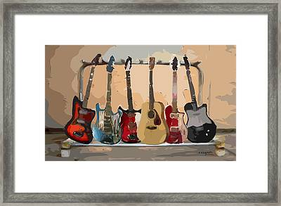 Guitars On A Rack Framed Print