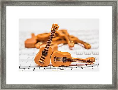 Guitars On Musical Notes Sheet Framed Print