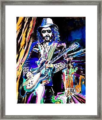 Guitarslinger Framed Print by John Leclerc