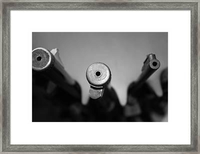 Gun Barrels Framed Print