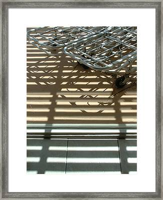 Gurneys Under A Pergola Through A Picture Window Framed Print
