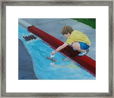 Gutter Boat Framed Print
