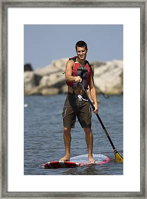 Guy Paddling On Paddleboard Framed Print by Christopher Purcell