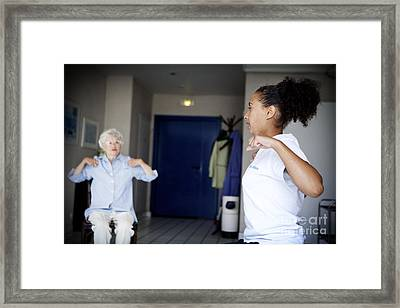 Gym Instructor With Elderly Person Framed Print