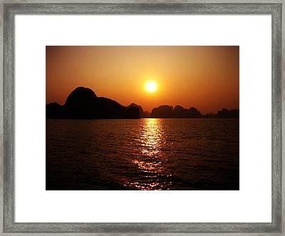 Ha Long Bay Sunset Framed Print by Oliver Johnston