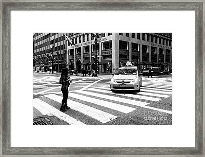 Hailing A Cab In Nyc Framed Print by John Rizzuto