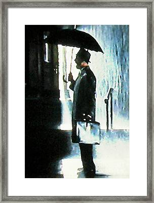 Hailing A Cab In The Rain Framed Print by John Malone