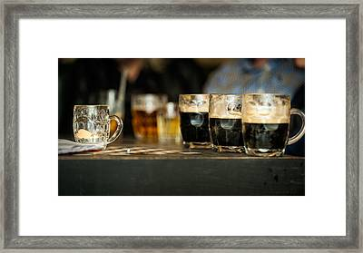 Half Full Beer Glasses On The Table Of A Bar Framed Print by Andrea Obzerova